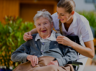 Old woman in a wheel chair with her caregiver