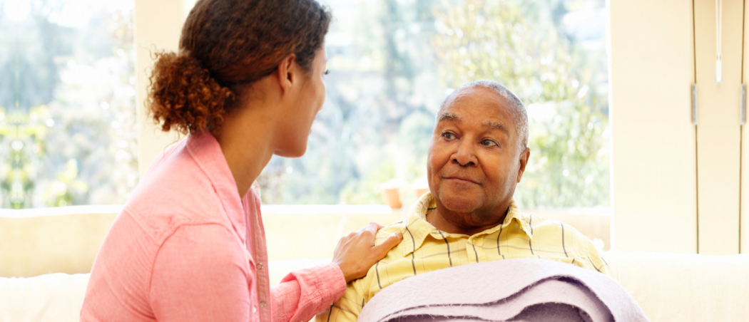Caretaker is talking to the old patient