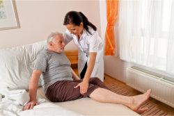 The nurse helps the man